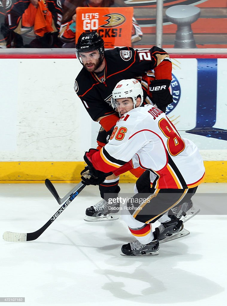 Kyle Palmieri #21 of the Anaheim Ducks battles Josh Jooris #86 of the Calgary Flames for position on the ice during the third period in Game Two of the Western Conference Semifinals during the 2015 NHL Stanley Cup Playoffs at Honda Center on May 3, 2015 in Anaheim, California. The Ducks won 3-0.