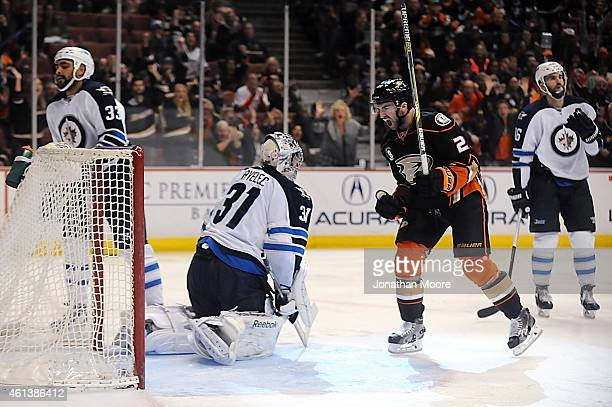 Kyle Palmieri of the Anaheim Ducks celebrates after scoring past Ondrej Pavelec of the Winnipeg Jets during a game at Honda Center on January 11 2015...