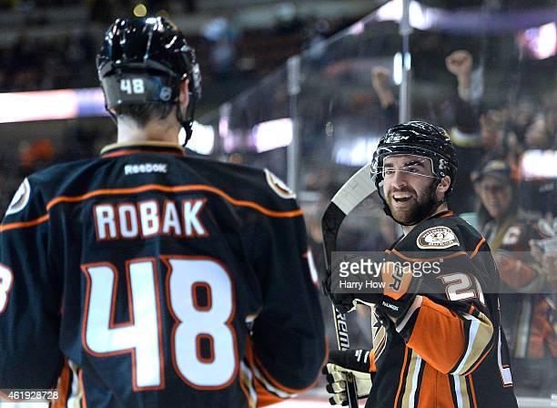Kyle Palmieri of the Anaheim Ducks celebrates his goal with Colby Robak to take a 10 lead over the Calgary Flames during the first period at Honda...