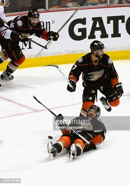 Kyle Palmieri of the Anaheim Ducks celebrates his second period goal with teammate Andrew Cogliano and Nate Thompson in Game One of the Western...