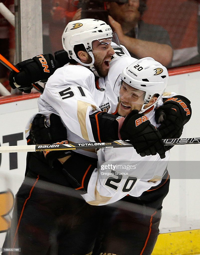 <a gi-track='captionPersonalityLinkClicked' href=/galleries/search?phrase=Kyle+Palmieri&family=editorial&specificpeople=4783296 ng-click='$event.stopPropagation()'>Kyle Palmieri</a> #51 of the Anaheim Ducks celebrates his second-period goal with teammate <a gi-track='captionPersonalityLinkClicked' href=/galleries/search?phrase=David+Steckel&family=editorial&specificpeople=685812 ng-click='$event.stopPropagation()'>David Steckel</a> #20 while playing the Detroit Red Wings in Game Six of the Western Conference Quarterfinals during the 2013 NHL Stanley Cup Playoffs at Joe Louis Arena on May 10, 2013 in Detroit, Michigan.
