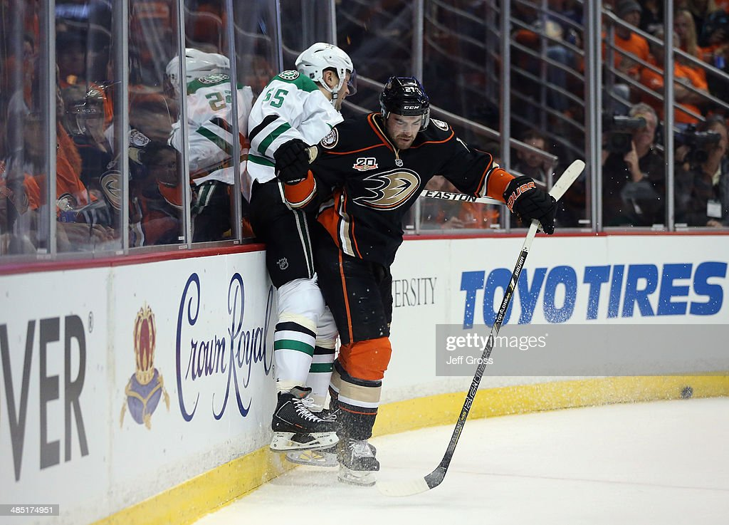 <a gi-track='captionPersonalityLinkClicked' href=/galleries/search?phrase=Kyle+Palmieri&family=editorial&specificpeople=4783296 ng-click='$event.stopPropagation()'>Kyle Palmieri</a> #21 of the Anaheim Ducks checks <a gi-track='captionPersonalityLinkClicked' href=/galleries/search?phrase=Sergei+Gonchar&family=editorial&specificpeople=202470 ng-click='$event.stopPropagation()'>Sergei Gonchar</a> #55 of the Dallas Stars into the boards in the first period of Game One of the First Round of the 2014 NHL Stanley Cup Playoffs at Honda Center on April 16, 2014 in Anaheim, California. The Ducks defeated the Stars 4-3.