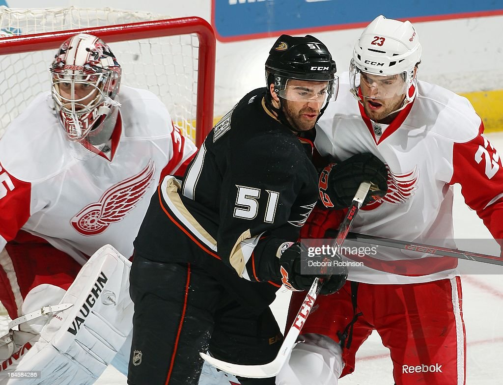 Kyle Palmieri #51 of the Anaheim Ducks delivers a shot to the chest of Brian Lashoff #23 of the Detroit Red Wings as goalie <a gi-track='captionPersonalityLinkClicked' href=/galleries/search?phrase=Jimmy+Howard&family=editorial&specificpeople=2118637 ng-click='$event.stopPropagation()'>Jimmy Howard</a> #35 looks onon March 24, 2013 at Honda Center in Anaheim, California.