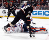 Kyle Palmieri of the Anaheim Ducks handles the puck against Viktor Fasth of the Edmonton Oilers on April 2 2014 at Honda Center in Anaheim California