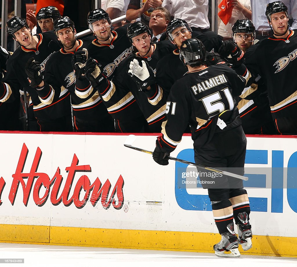 Kyle Palmieri #51 of the Anaheim Ducks is congratulated by teammates after scoring a goal against the Detroit Red Wings in Game Two of the Western Conference Quarterfinals during the 2013 NHL Stanley Cup Playoffs at Honda Center on May 2, 2013 in Anaheim, California.
