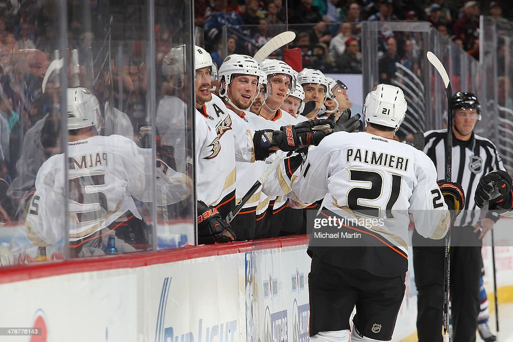 <a gi-track='captionPersonalityLinkClicked' href=/galleries/search?phrase=Kyle+Palmieri&family=editorial&specificpeople=4783296 ng-click='$event.stopPropagation()'>Kyle Palmieri</a> #21 of the Anaheim Ducks is congratulated by teammates after scoring a second period goal against the Colorado Avalanche at the Pepsi Center on March 14, 2014 in Denver, Colorado.