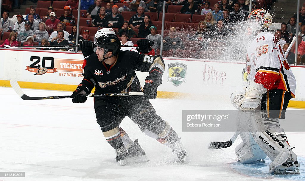 <a gi-track='captionPersonalityLinkClicked' href=/galleries/search?phrase=Kyle+Palmieri&family=editorial&specificpeople=4783296 ng-click='$event.stopPropagation()'>Kyle Palmieri</a> #21 of the Anaheim Ducks skates in front of <a gi-track='captionPersonalityLinkClicked' href=/galleries/search?phrase=Joey+MacDonald&family=editorial&specificpeople=2234367 ng-click='$event.stopPropagation()'>Joey MacDonald</a> #35 of the Calgary Flames on October 16, 2013 at Honda Center in Anaheim, California.