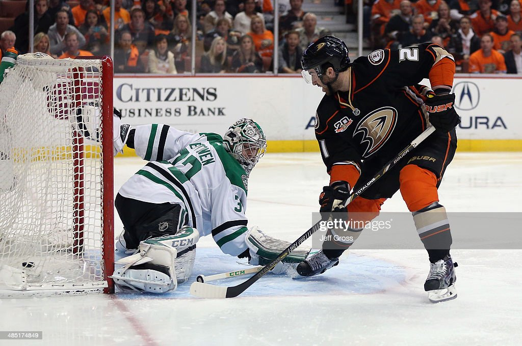 <a gi-track='captionPersonalityLinkClicked' href=/galleries/search?phrase=Kyle+Palmieri&family=editorial&specificpeople=4783296 ng-click='$event.stopPropagation()'>Kyle Palmieri</a> #21 of the Anaheim Ducks slides the puck past goaltender <a gi-track='captionPersonalityLinkClicked' href=/galleries/search?phrase=Kari+Lehtonen&family=editorial&specificpeople=211612 ng-click='$event.stopPropagation()'>Kari Lehtonen</a> #32 of the Dallas Stars for a goal in the first period of Game One of the First Round of the 2014 NHL Stanley Cup Playoffs at Honda Center on April 16, 2014 in Anaheim, California. The Ducks defeated the Stars 4-3.