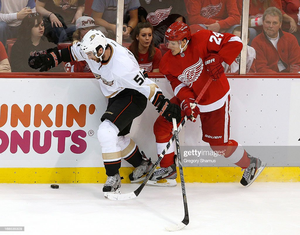 <a gi-track='captionPersonalityLinkClicked' href=/galleries/search?phrase=Kyle+Palmieri&family=editorial&specificpeople=4783296 ng-click='$event.stopPropagation()'>Kyle Palmieri</a> #51 of the Anaheim Ducks tries to control the puck next to <a gi-track='captionPersonalityLinkClicked' href=/galleries/search?phrase=Damien+Brunner&family=editorial&specificpeople=6931570 ng-click='$event.stopPropagation()'>Damien Brunner</a> #24 of the Detroit Red Wings in Game Six of the Western Conference Quarterfinals during the 2013 NHL Stanley Cup Playoffs at Joe Louis Arena on May 10, 2013 in Detroit, Michigan. Detroit won the game in overtime 4-3 to tie the series 3-3.