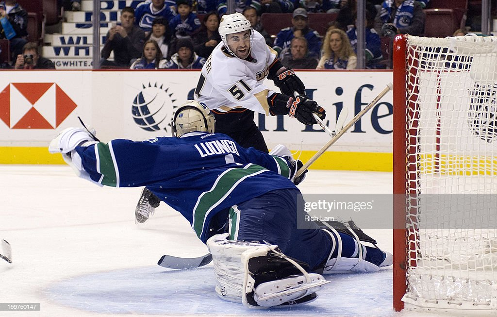 Kyle Palmieri #51 of the Anaheim Ducks watches the puck hit the cross bar after goalie <a gi-track='captionPersonalityLinkClicked' href=/galleries/search?phrase=Roberto+Luongo&family=editorial&specificpeople=202638 ng-click='$event.stopPropagation()'>Roberto Luongo</a> #1 of the Vancouver Canucks made the save during the third period in NHL action on January 20, 2013 at Rogers Arena in Vancouver, British Columbia, Canada.