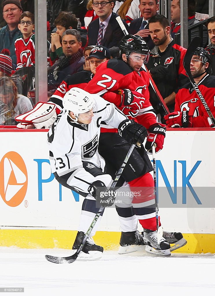 <a gi-track='captionPersonalityLinkClicked' href=/galleries/search?phrase=Kyle+Palmieri&family=editorial&specificpeople=4783296 ng-click='$event.stopPropagation()'>Kyle Palmieri</a> #21 of the New Jersey Devils and <a gi-track='captionPersonalityLinkClicked' href=/galleries/search?phrase=Dustin+Brown+-+Ice+Hockey+Player&family=editorial&specificpeople=4175092 ng-click='$event.stopPropagation()'>Dustin Brown</a> #23 of the Los Angeles Kings come together at the boards during the game at the Prudential Center on February 14, 2016 in Newark, New Jersey.