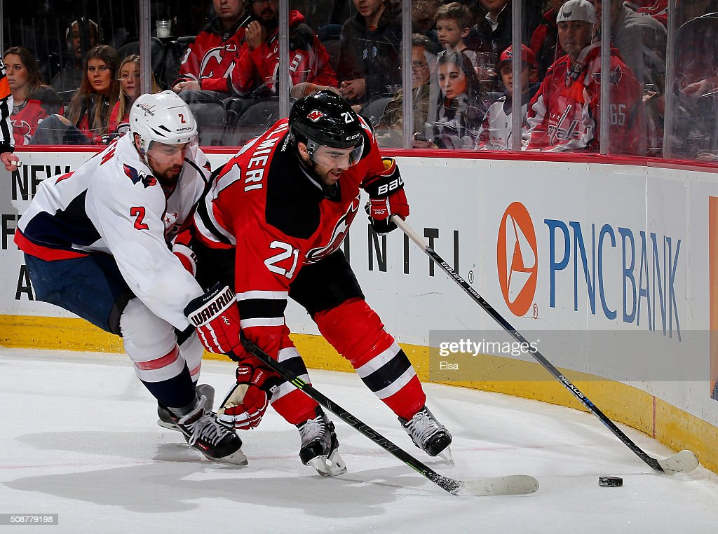 <a gi-track='captionPersonalityLinkClicked' href=/galleries/search?phrase=Kyle+Palmieri&family=editorial&specificpeople=4783296 ng-click='$event.stopPropagation()'>Kyle Palmieri</a> #21 of the New Jersey Devils and <a gi-track='captionPersonalityLinkClicked' href=/galleries/search?phrase=Matt+Niskanen&family=editorial&specificpeople=2106633 ng-click='$event.stopPropagation()'>Matt Niskanen</a> #2 of the Washington Capitals fight for the puck in the overtime period on February 6, 2016 at Prudential Center in Newark, New Jersey.The Washington Capitals defeated the New Jersey Devils 3-2 in an overtime shootout.