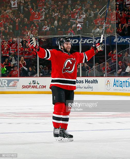 Kyle Palmieri of the New Jersey Devils celebrates after a goal by Sergey Kalinin against the Detroit Red Wings at the Prudential Center on December...