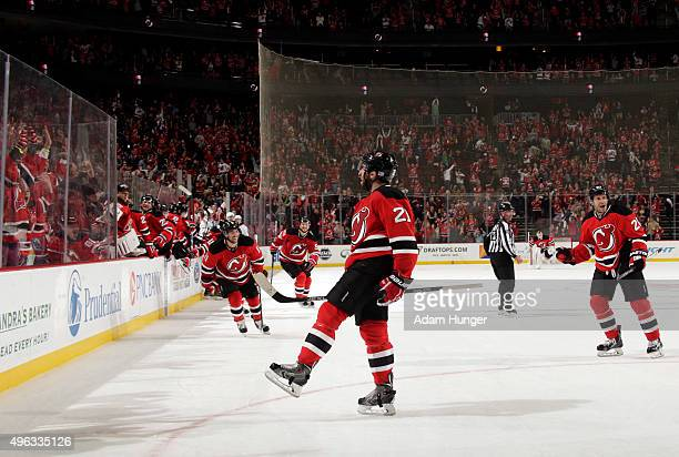 Kyle Palmieri of the New Jersey Devils celebrates after scoring the game winning goal against the Vancouver Canucks during overtime at the Prudential...