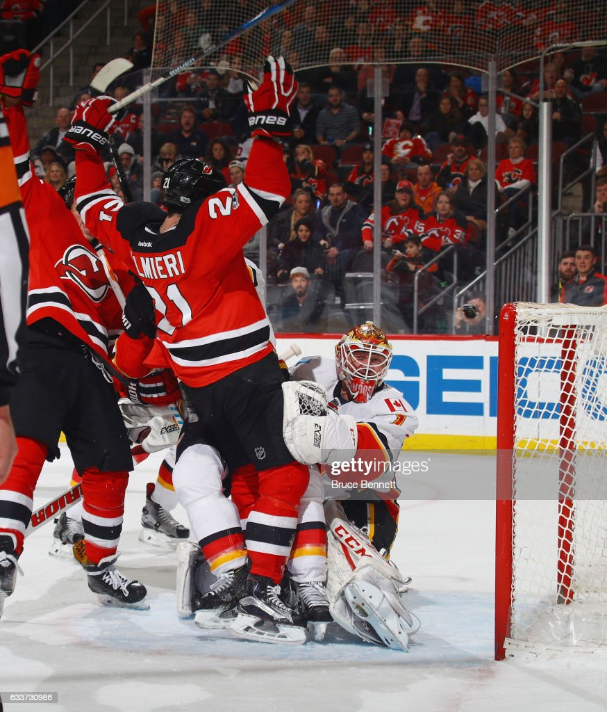 Kyle Palmieri #21 of the New Jersey Devils celebrates his powerplay goal against Brian Elliott #1 of the Calgary Flames at 19:36 of the second period at the Prudential Center on February 3, 2017 in Newark, New Jersey.