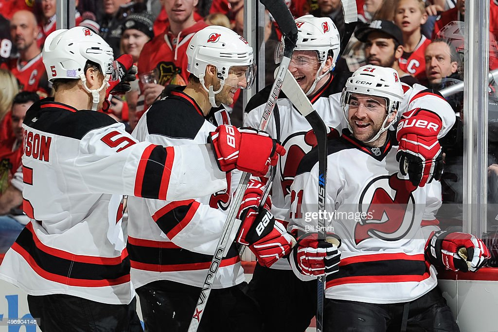 <a gi-track='captionPersonalityLinkClicked' href=/galleries/search?phrase=Kyle+Palmieri&family=editorial&specificpeople=4783296 ng-click='$event.stopPropagation()'>Kyle Palmieri</a> #21 of the New Jersey Devils celebrates with <a gi-track='captionPersonalityLinkClicked' href=/galleries/search?phrase=Adam+Larsson&family=editorial&specificpeople=6705080 ng-click='$event.stopPropagation()'>Adam Larsson</a> #5, <a gi-track='captionPersonalityLinkClicked' href=/galleries/search?phrase=Travis+Zajac&family=editorial&specificpeople=864182 ng-click='$event.stopPropagation()'>Travis Zajac</a> #19 and Sergey Kalinin #51 after scoring in the second period of the NHL game against the Chicago Blackhawks at the United Center on November 12, 2015 in Chicago, Illinois.