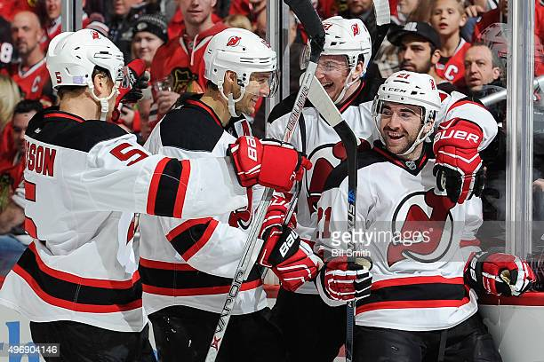 Kyle Palmieri of the New Jersey Devils celebrates with Adam Larsson Travis Zajac and Sergey Kalinin after scoring in the second period of the NHL...