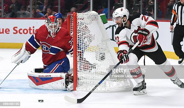 Kyle Palmieri of the New Jersey Devils controls the puck against Mike Condon of the Montreal Canadiens in the NHL game at the Bell Centre on November...