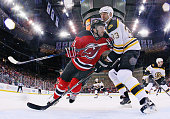 Kyle Palmieri of the New Jersey Devils goes against Zdeno Chara of the Boston Bruins during the first period at the Prudential Center on January 8...