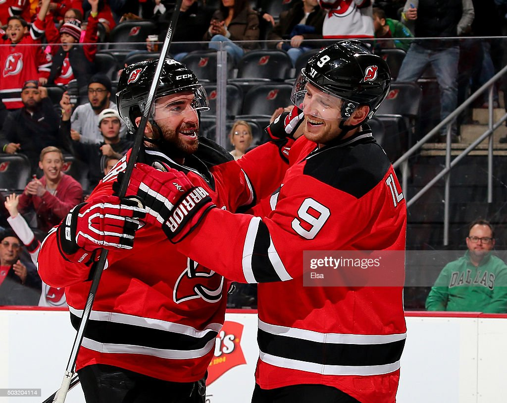 <a gi-track='captionPersonalityLinkClicked' href=/galleries/search?phrase=Kyle+Palmieri&family=editorial&specificpeople=4783296 ng-click='$event.stopPropagation()'>Kyle Palmieri</a> #21 of the New Jersey Devils is congratulated by teammate <a gi-track='captionPersonalityLinkClicked' href=/galleries/search?phrase=Jiri+Tlusty&family=editorial&specificpeople=543236 ng-click='$event.stopPropagation()'>Jiri Tlusty</a> #9 after Palmieri scored a goal in the second period against the Dallas Stars on January 2,2016 at Prudential Center in Newark, New Jersey.