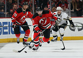 Kyle Palmieri of the New Jersey Devils skates against the Pittsburgh Penguins at the Prudential Center on November 14 2015 in Newark New Jersey The...
