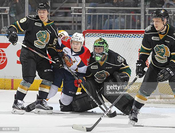 Kyle Petit of the Erie Otters squeezes between Mitchell Vande Sompel and Tyler Parsons of the London Knights during an OHL game at Budweiser Gardens...