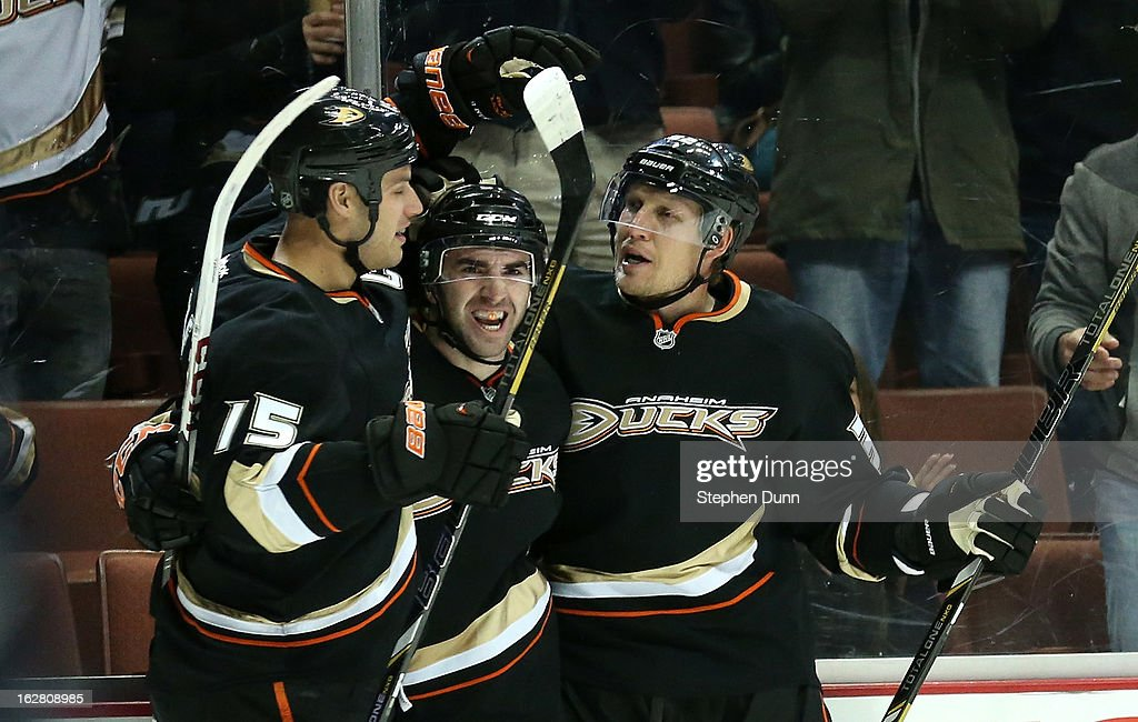 Kyle Plamieri #51 (C) of the Anaheim Ducks celebrates with Ryan Getzlaf #15 and Toni Lydman #32 after scoring the Ducks' second goal of the first period against the Nashville Predators at Honda Center on February 27, 2013 in Anaheim, California.