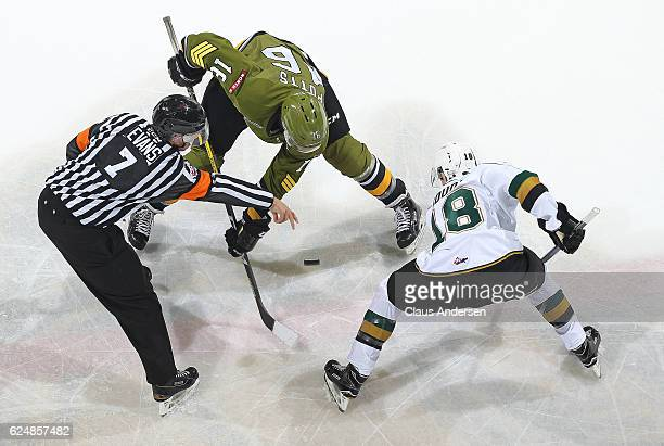 Kyle Potts of the North Bay Battalion takes a faceoff against Liam Foudy of the London Knights during an OHL game at the Budweiser Gardens on...