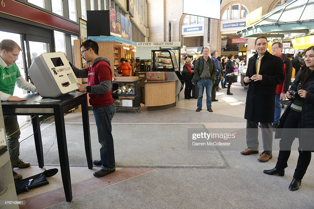 Kyle Powers (L) and Chris Yim of Liberty Teller install a Bitcoin ATM at South Station February 20, 2014 in Boston, Massachusetts. The ATM was placed by Liberty Teller to help inform people about the digital currency, which can be bought and sold anonymously, and can be used at a number of online retailers in place of cash or credit cards.