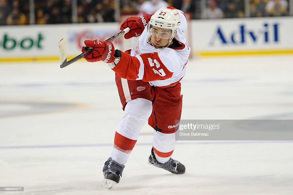 Kyle Quicney of the Detroit Red Wings shoots the puck against the Boston Bruins in Game One of the First Round of the 2014 Stanley Cup Playoffs at TD...