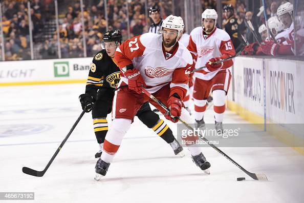 Kyle Quicney of the Detroit Red Wings skates with the puck against the Boston Bruins at the TD Garden on March 8 2015 in Boston Massachusetts
