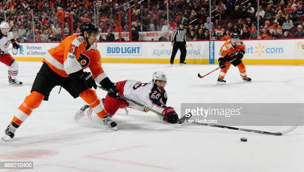 Kyle Quincey of the Columbus Blue Jackets makes a diving defensive play against Valtteri Filppula of the Philadelphia Flyers on April 8 2017 at the...