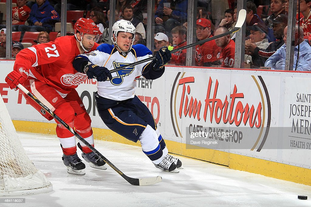 <a gi-track='captionPersonalityLinkClicked' href=/galleries/search?phrase=Kyle+Quincey&family=editorial&specificpeople=2234340 ng-click='$event.stopPropagation()'>Kyle Quincey</a> #27 of the Detroit Red Wings and <a gi-track='captionPersonalityLinkClicked' href=/galleries/search?phrase=Vladimir+Sobotka&family=editorial&specificpeople=716736 ng-click='$event.stopPropagation()'>Vladimir Sobotka</a> #17 of the St. Louis Blues race for the puck behind the net during an NHL game on January 20, 2014 at Joe Louis Arena in Detroit, Michigan. The Blues defeated the Wings 4-1