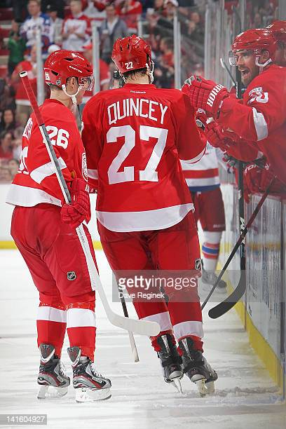 Kyle Quincey of the Detroit Red Wings celebrates his goal with teammates during an NHL game against the Washington Capitals at Joe Louis Arena on...