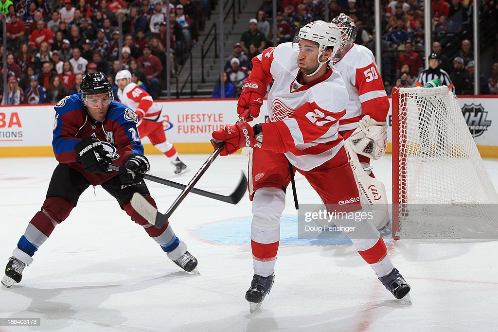 <a gi-track='captionPersonalityLinkClicked' href=/galleries/search?phrase=Kyle+Quincey&family=editorial&specificpeople=2234340 ng-click='$event.stopPropagation()'>Kyle Quincey</a> #27 of the Detroit Red Wings clears the puck against <a gi-track='captionPersonalityLinkClicked' href=/galleries/search?phrase=Paul+Stastny&family=editorial&specificpeople=2494330 ng-click='$event.stopPropagation()'>Paul Stastny</a> #26 of the Colorado Avalanche at Pepsi Center on October 17, 2013 in Denver, Colorado.