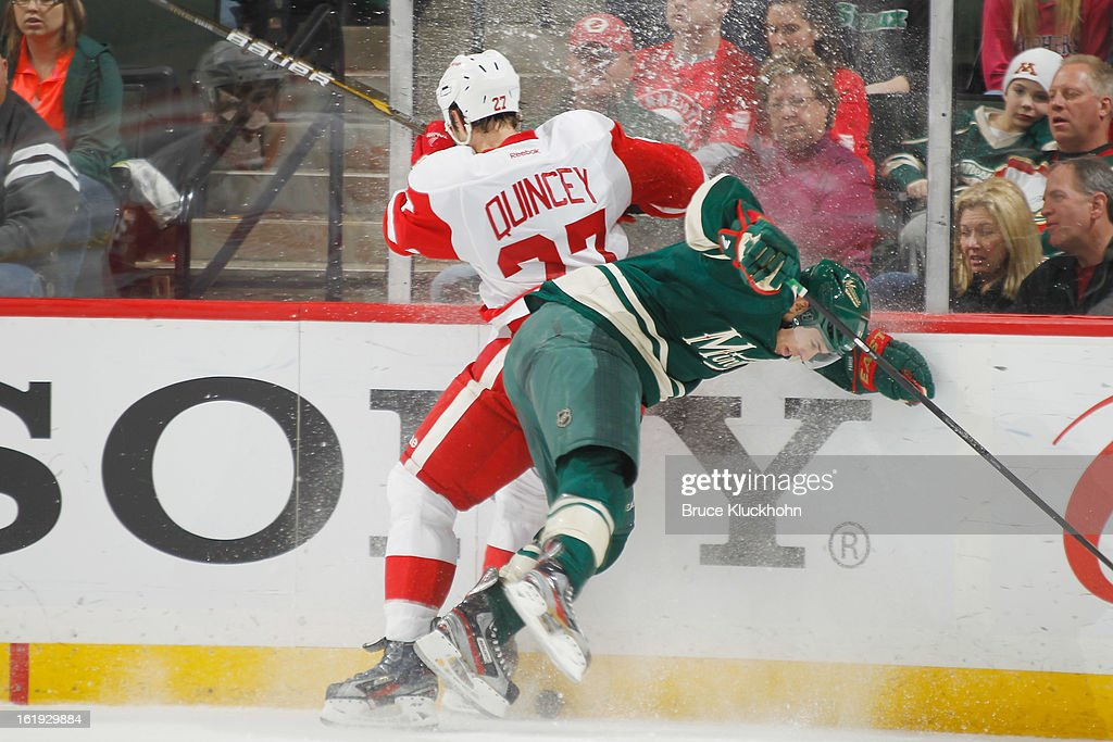 <a gi-track='captionPersonalityLinkClicked' href=/galleries/search?phrase=Kyle+Quincey&family=editorial&specificpeople=2234340 ng-click='$event.stopPropagation()'>Kyle Quincey</a> #23 of the Detroit Red Wings collides with <a gi-track='captionPersonalityLinkClicked' href=/galleries/search?phrase=Zach+Parise&family=editorial&specificpeople=213606 ng-click='$event.stopPropagation()'>Zach Parise</a> #11 of the Minnesota Wild during the game on February 17, 2013 at the Xcel Energy Center in Saint Paul, Minnesota.