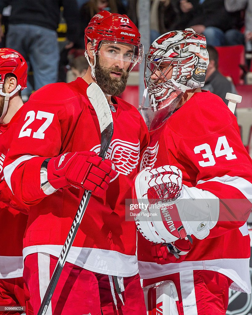 Kyle Quincey of the Detroit Red Wings congratulates teammate Petr Mrazek after defeating the Ottawa Senators 31 in an NHL game at Joe Louis Arena on...