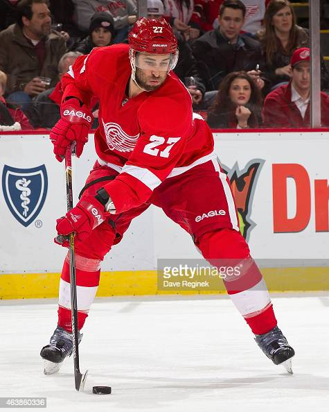 Kyle Quincey of the Detroit Red Wings controls the puck during a NHL game against the Winnipeg Jets on February 14 2015 at Joe Louis Arena in Detroit...