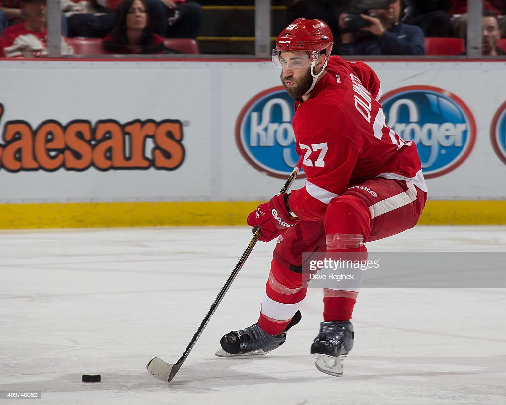 Kyle Quincey of the Detroit Red Wings controls the puck during a NHL game against the Carolina Hurricanes on April 7 2015 at Joe Louis Arena in...