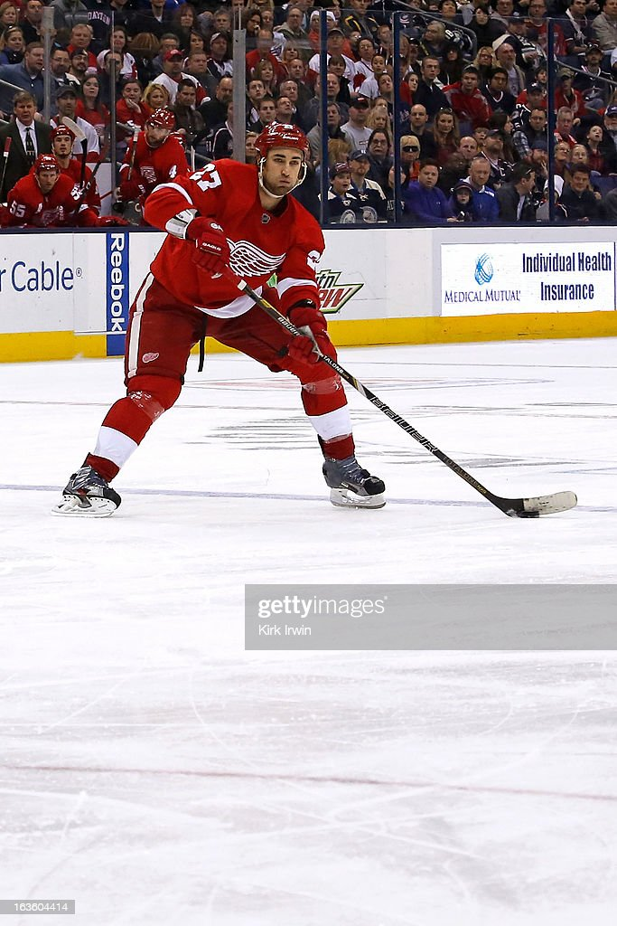 Kyle Quincey #27 of the Detroit Red Wings controls the puck during the game against the Columbus Blue Jackets on March 9, 2013 at Nationwide Arena in Columbus, Ohio.