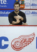 Kyle Quincey of the Detroit Red Wings gets ready before their warmups prior to an NHL game against the Nashville Predators at Joe Louis Arena on...