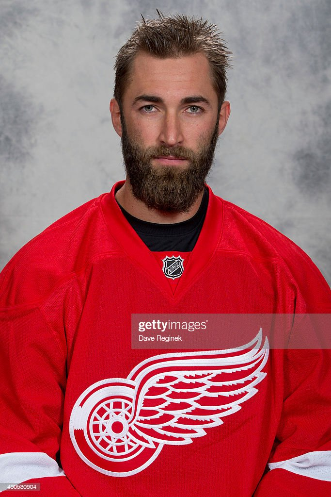 Kyle Quincey of the Detroit Red Wings has his official NHL head shot taken at Centre Ice Arena on September 17 2015 in Traverse City Michigan