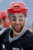 Kyle Quincey of the Detroit Red Wings looks smiles during the 2014 Bridgestone NHL Winter Classic team practice session on December 31 2013 at...