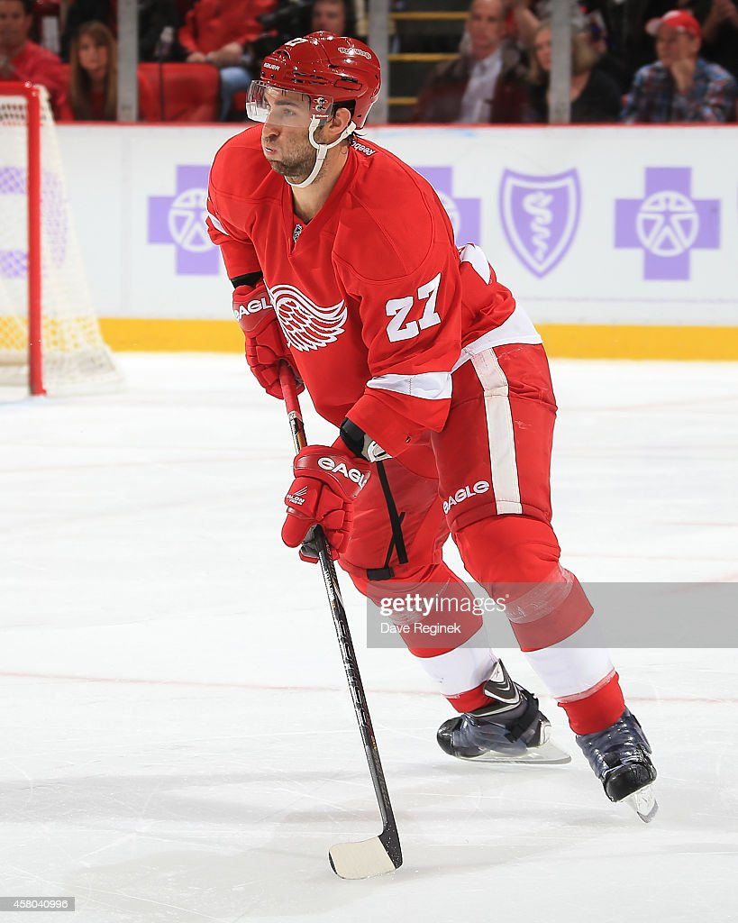 Kyle Quincey of the Detroit Red Wings looks to pass the puck against the Pittsburgh Penguins during a NHL game on October 23 2014 at Joe Louis Arena...