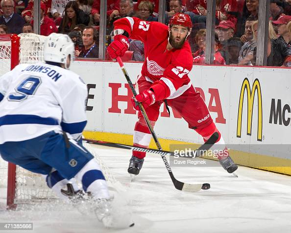 Kyle Quincey of the Detroit Red Wings moves the puck as Tyler Johnson of the Tampa Bay Lightning pressures him in Game Six of the Eastern Conference...