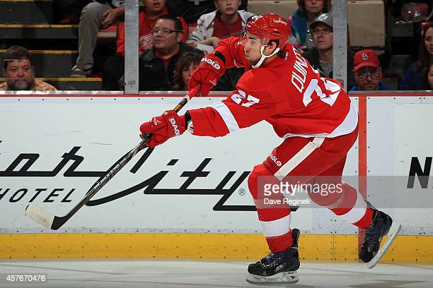 Kyle Quincey of the Detroit Red Wings passes the puck against the Toronto Maple Leafs during a NHL game on October 18 2014 at Joe Louis Arena in...