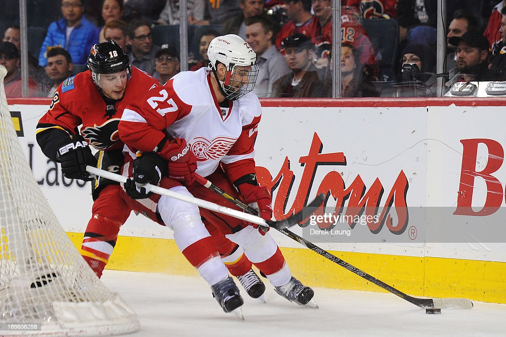 <a gi-track='captionPersonalityLinkClicked' href=/galleries/search?phrase=Kyle+Quincey&family=editorial&specificpeople=2234340 ng-click='$event.stopPropagation()'>Kyle Quincey</a> #27 of the Detroit Red Wings skates against Matt Stajan #18 of the Calgary Flames during an NHL game at Scotiabank Saddledome on April 17, 2013 in Calgary, Alberta, Canada.