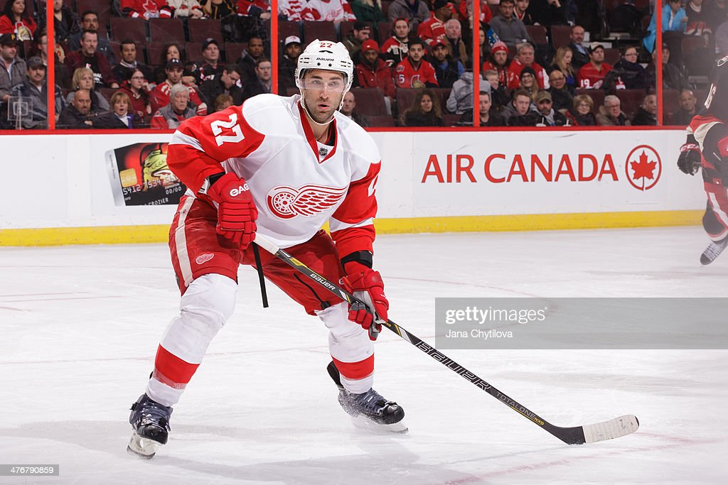 Kyle Quincey of the Detroit Red Wings skates against the Ottawa Senators during an NHL game at Canadian Tire Centre on February 27 2014 in Ottawa...
