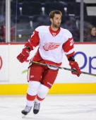Kyle Quincey of the Detroit Red Wings skates during warmups before an NHL game against the Calgary Flames at Scotiabank Saddledome on April 17 2013...