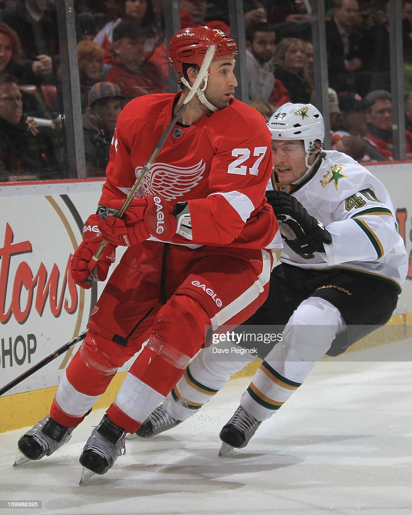 Kyle Quincey #27 of the Detroit Red Wings skates in front of Ryan Garbutt #40 of the Dallas Stars battle for the puck during a NHL game at Joe Louis Arena on January 22, 2013 in Detroit, Michigan. Dallas won 2-1